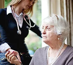 personal support worker helping a senior with dimentia