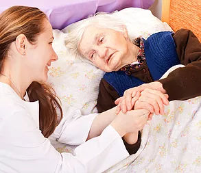 palliative disease care, nurse comforting senior
