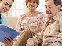 healthcare worker helping family with a mental health assessment